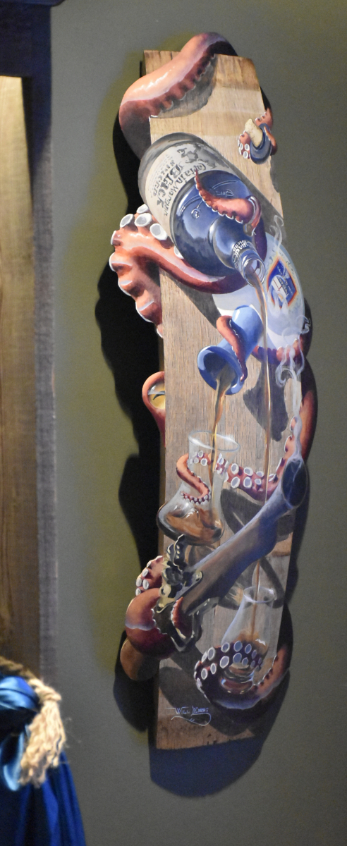 Side view of painting of octopus pouring rum